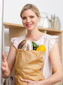 Attractive woman holding a grocery bag — Stock Photo