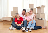 Tired family relaxing while moving house — Stock Photo