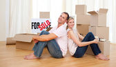 Smiling couple relaxing while moving — Stock Photo