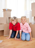 Jolly sibling while moving house — Stock Photo