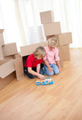 Adorable sibling playing with a train — Stock Photo