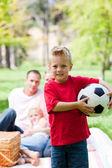 Little boy holding a soccer ball — Stock Photo