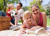 Happy young family enjoying a picnic — Stock Photo