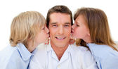 Adorable siblings kissing their father — Stock Photo