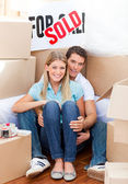 Intimate couple embracing after move in — Stock Photo