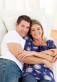 Affectionate couple lying down on sofa — Stock Photo