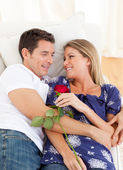 Enamored lovers relaxing on sofa — Stock Photo