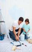 Lively Father and his son painting in their new house — Stock Photo