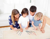 Loving family playing mikado in the living room — Stock Photo