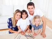 Cheerful family playing mikado in the living room — Stock Photo