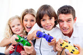 Animated family playing video game — Stock Photo