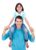 Tender chil enjoying piggyback ride with his father — Stock Photo