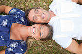 Happy couple lying on the grass — Stock Photo