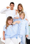 Jolly family brushing their teeth — Stock Photo