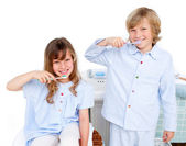 Cute children brushing their teeth — Stock Photo