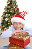 Portrait of a smiling boy wearing a Christmas hat — Stockfoto