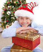 Happy little boy with Christmas presents — Stock Photo