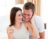 Cheerful couple finding out results of a pregnancy test — Stock Photo