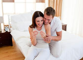 Jolly couple finding out results of a pregnancy test — Stock Photo
