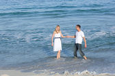 Lively lovers having fun at the seaside — Stock Photo