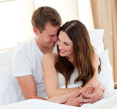 Romantic lovers embracing lying in bed — Stock Photo