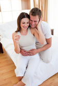 Blissful couple finding out results of a pregnancy test — Stock Photo