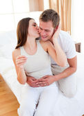 Affectionate couple finding out results of a pregnancy test — Stock Photo