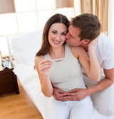 Attentive couple finding out results of a pregnancy test — Stock Photo