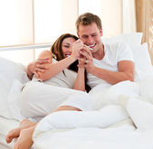 Lively couple finding out results of a pregnancy test — Stock Photo