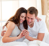 Joyful couple finding out results of a pregnancy test — Stockfoto