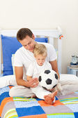 Adorable little boy and his father playing with a soccer ball — Stock Photo