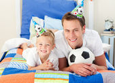 Happy child and his father playing with a soccer ball — Stock Photo