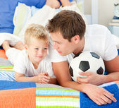 Attentive father and his son playing with a soccer ball — Stock Photo