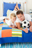Handsome father and his son playing with a soccer ball — Stock Photo