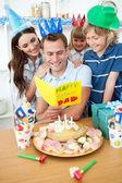 Happy family celebrating father's birthday — Stock fotografie