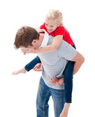 Lively father giving his daughter piggyback ride — Stock Photo
