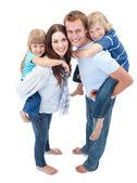 Loving family enjoying piggyback ride — Stock Photo