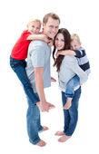 Merry family enjoying piggyback ride — Stock Photo