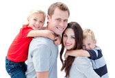 Portrait of joyful family enjoying piggyback ride against a whit — Stock Photo