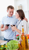 Romantic couple drinking wine while cooking — Stock Photo