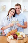 Happy couple drinking white wine — Stock Photo