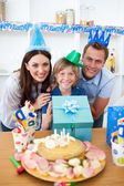 Lively parents celebrating their son's birthday — Stock Photo