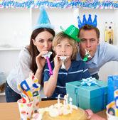 Jolly parents celebrating their son's birthday — Stock Photo