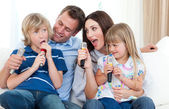 Happy parents and children having fun together — Stock Photo