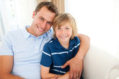 Portrait of an attractive father hugging his son — Stock Photo