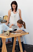 Mother and her daughter preparing paint — Стоковое фото