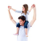 Charming father giving his daughter piggyback ride — Stock Photo