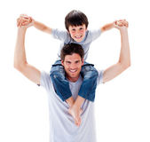 Charismatic father giving his son piggyback ride — Stock Photo