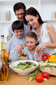 Happy family cooking together — Stock Photo