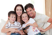 Portrait of a happy family watching TV — Stock Photo